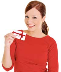 A young girl is holding a gift card in her hand.